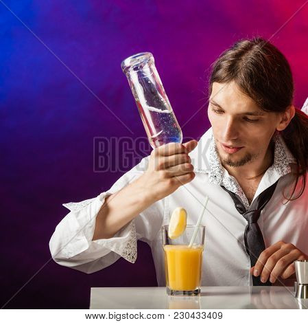 Alcohol Liquor Drinking Party Relax Bartending Concept. Young Bartender Pouring Beverages. Male Barm