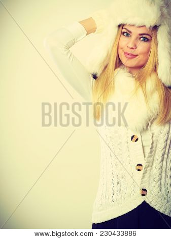 Winter Clothing, People, Fashion Concept. Blonde Woman With Fur Cap. Attractive Lady Has White Outfi
