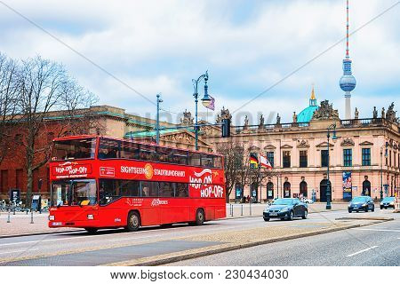 Berlin, Germany - December 12, 2017: Red Excursion Bus At Humboldt University With Television Tower