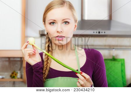 Woman In Kitchen Holding Green Fresh Chive With Onion. Young Housewife Cooking. Healthy Eating, Vege