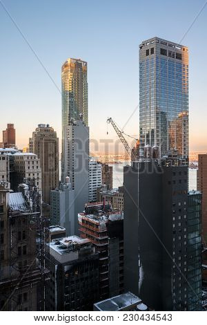 New York-march 8: An Early Morning View Of A Large Crane High Up On A Skyscraper On March 8 2018 In