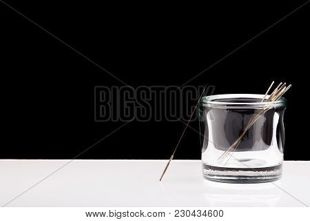 Silver Needles For Traditional Chinese Medicine Acupuncture. Close-up. Black And White Background. T
