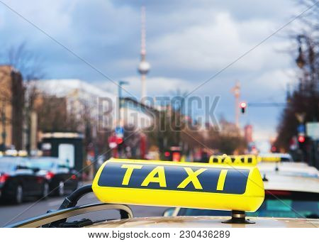 Taxi Sign Board On The Street Of Berlin, Germany. Television Tower On The Background