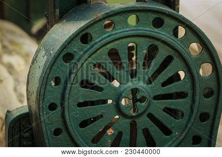 Old Tool Of Metal And Wooden Painted In Dark Green Color