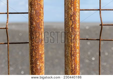Iron Fence With Corrosion Before Ocean In La Palma.