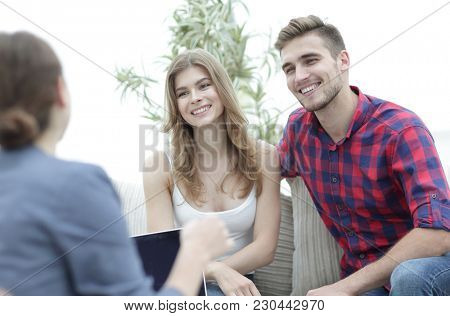 Young happy couple at therapy session with family psychologist