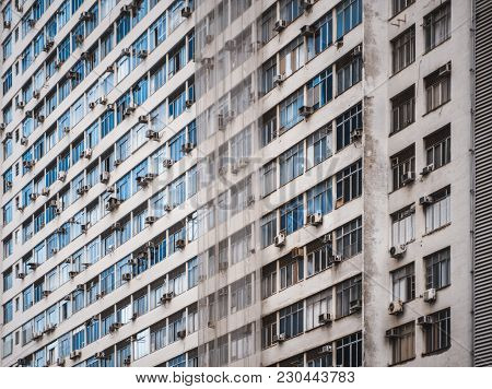 Side View Of A Regular Beige High-rise Apartment Building In Rio De Janeiro, Brazil Without Balconie