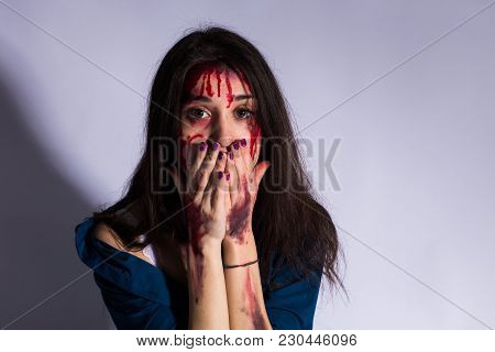 Rape Battered Bloody Victim Sad Woman Sits On The Floor Of A Dark Tunnel. Sexual Assault Concept Rea