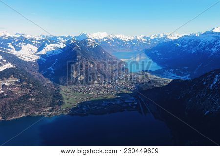 The Center Of Bernese Apline City Of Interlaken In Winter Swiss Alps, Helicopter View. Thun Lake And