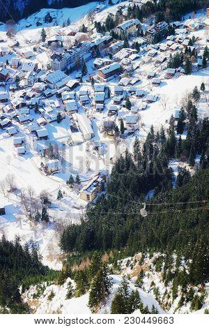 Aerial View To Wengen Village In Bernese Oberland In Switzerland.
