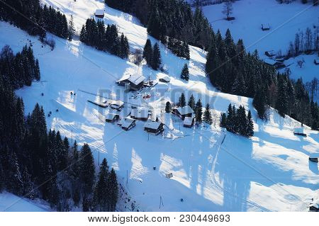 Aerial View Of Flying Helicopter And Small Village In Bernese Oberland In Switzerland.