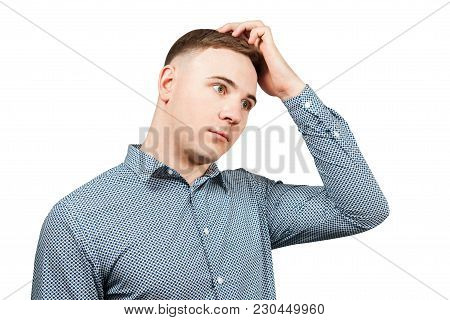 Portrait Of Young Thinking Guy Scratching Head. Isolated On White.