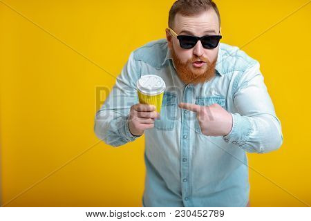 Indignant Red Beard Man In Sunglasses And Denim Shirt Holding Paper Cup With Coffee. What Is It