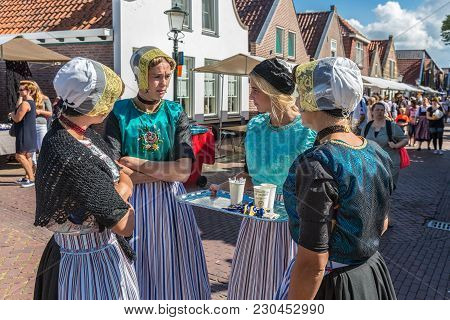 Urk, The Netherlands - September 02, 2017: Four Young Women With Traditional Clothing And Headgear A