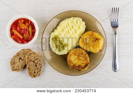 Cutlets From Cabbage With Mashed Potato, Bowl With Lecho, Pieces Of Bread And Fork On Wooden Table.