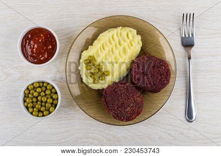 Cutlets From Beetroot With Mashed Potato, Bowls With Green Peas, Ketchup And Fork On Wooden Table. T