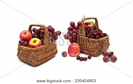 Cherries, Grapes And Apples In A Basket On A White Background. Horizontal Photo.