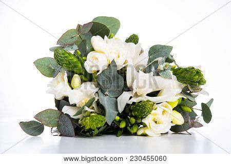 Sophisticated Bridal Bouquet Of Flowers, White Freesias And Orchids On A White Background Isolated