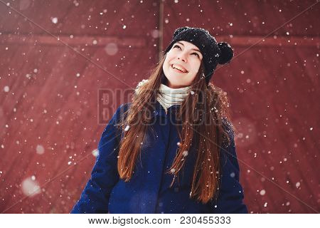 Winter Portrait Of A Young Woman. Beauty Joyous Model A Girl Laughs And Is Happy To Have A Dark Red