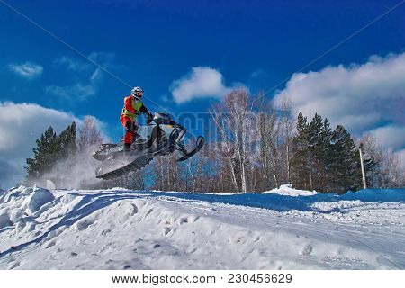 Extreme Sport Race Snowmobiles. Snowmobile In Jump Above Track. Sportsman On Snowmobile. Winter Comp