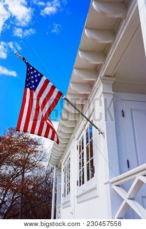 American Flag On Sandy Hook Light House Museum. It Is The Oldest Lighthouse Still Working Now. Sandy