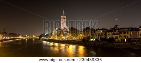 Cityscape Of Verona At Night With The Adige River, The Church Of Santa Anastasia And The Lamberti To