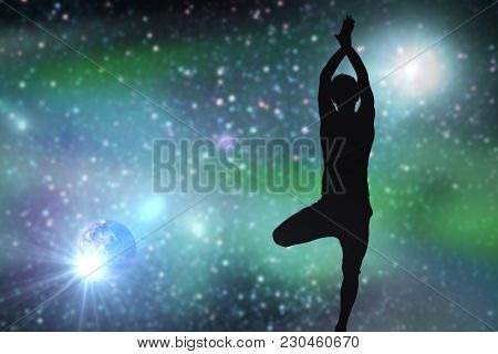 fitness, mindfulness and harmony concept - black silhouette of man doing yoga tree pose over space background