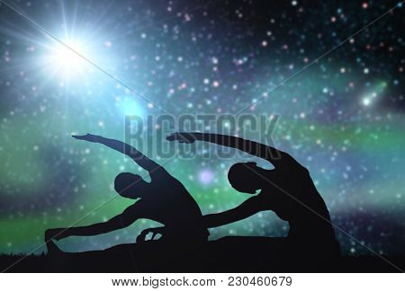 fitness, mindfulness and harmony concept - black silhouette of couple making yoga exercises over space background
