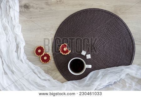 On A Wooden Table On A White And Dark Round Napkin Lie Biscuits With Red Jelly Sunflower Seeds Are A