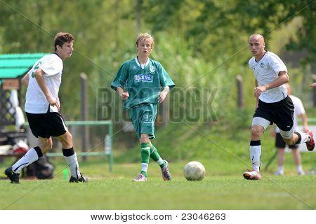 KAPOSVAR, HUNGARY - AUGUST 27: Krisztian Nagy (C) in action at the Hungarian National Championship under 18 game between Kaposvar (green) and Gyor (white) August 27, 2011 in Kaposvar, Hungary.