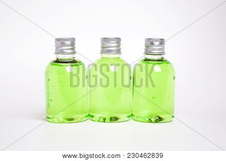 Several Small Cans Of Cream Of White And Green. With Small Little Bubbles Transparent.