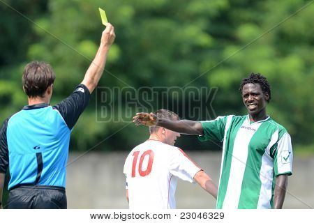 KAPOSVAR, HUNGARY - AUGUST 27: Attila Ereth (referee) in action at a Hungarian National Championship III. soccer game Kaposvar (green) vs. Szentlorinc (white) August 27, 2011 in Kaposvar, Hungary.