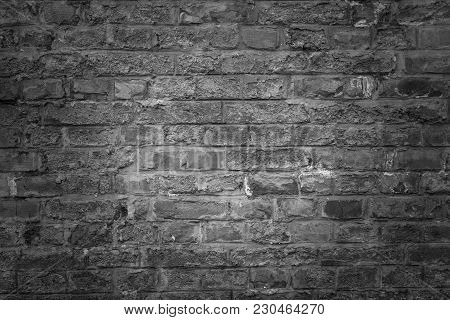 Old Brick Wall As Background, Texture Or Pattern. Dark Wall. Poster Or Cover. Black And White Brick