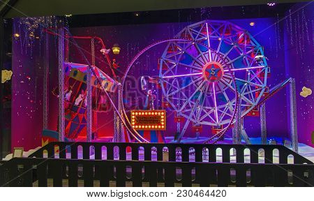 Paris, France - December 12, 2017: Christmas Decorations In The Shop Window Of A Parisian Galeries L