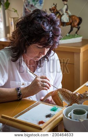 Herend, Veszprem / Hungary - August 03, 2012 - A Herend Porcelain Painter Demonstrates How To Paint