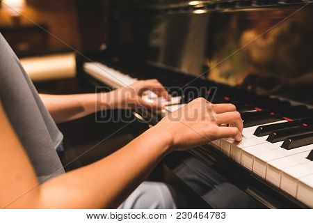 Asian Woman Hand Playing Keyboard Of A Piano In Romantic Atmosphere. Music Instrument, Solo Pianist,
