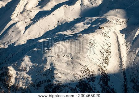 Looking Down From Above At Ski Slopes And A Ski Resort High In The European Alps In France And Italy