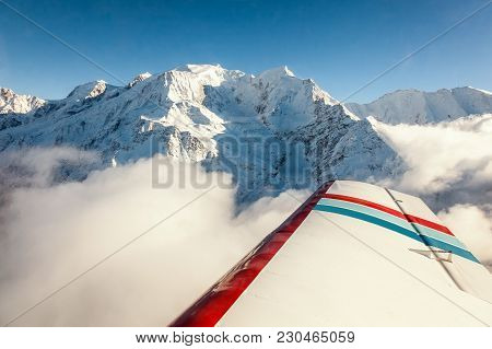 Aerial View Of Snow Covered Mont Blanc French Alps Mountain Peak In Winter On A Clear, Blue, Cold An