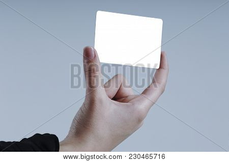 Female Hand Holding Isolated Card With Two Fingers Close Up