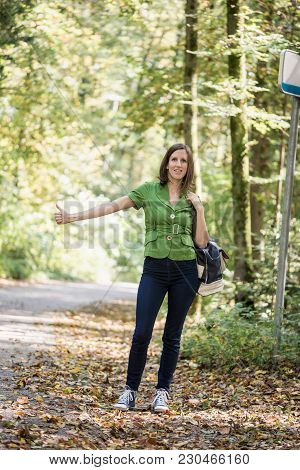 Front View Of A Woman Hitchhiker