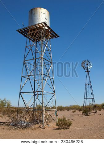 An Old Water Tower And Windmill Of An Abandoned Cattle Ranch On Webb Mountain In The Gila Bend Mount
