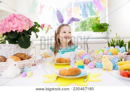 Kids At Easter Breakfast. Eggs Basket, Bunny Ears.