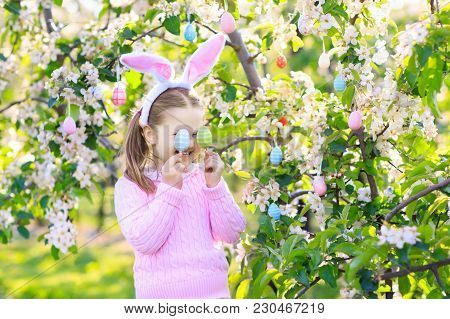 Child With Bunny Ears On Garden Easter Egg Hunt