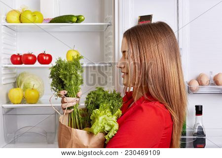People, Lifestyle And Healthy Eating Concept. Sideways Shot Of Adorable Woman Holds Paper Box With D