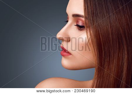 People, Beauty Concept. Sideways Portrait Of Nude Brunette Female With Wonderful Make Up, Red Painte