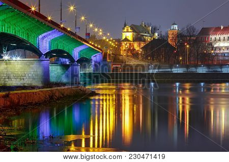 Slasko-dabrowski Bridge In Old Town With Reflection In The Vistula River During Evening Blue Hour, W