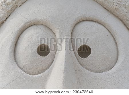 Eyes In Sand On Face Sand Sculpture Close Up