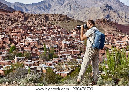 Abyaneh,  Isfahan Province, Iran - April 26, 2017: One Tourist Of Caucasian Appearance, With A Backp