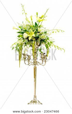 Wedding flower arrangement centerpiece with orchid, rose, lily, calla lily on Victorian candelabra