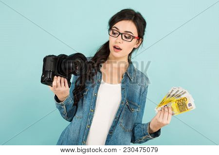 Portrait Of Young Attractive Happy Woman Photographer In Denim And Glasses Shirt Holding Camera And